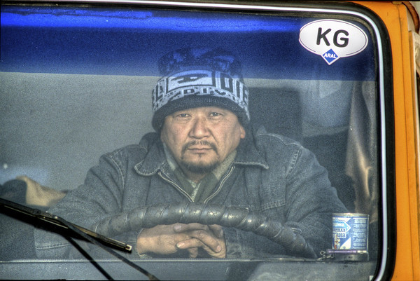 A driver, exhausted after days of driving on the Pamir Highway in the winter, dream eyes open